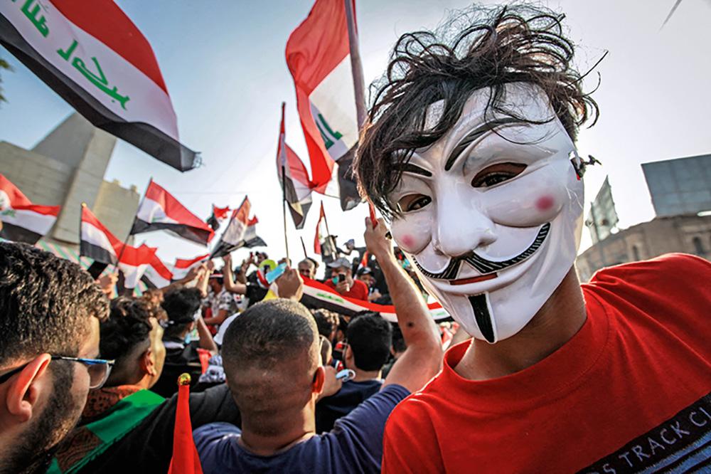 Manifestant arborant un masque de GuyFawkes, Bagdad, Irak, 30octobre2019 ©DPA/ Photononstop